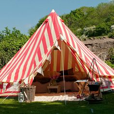 """You don't need a camper to glam things up when spending time outdoors. Many tents are getting down with the """"glamping"""" trend, and with the addition of some cozy pillows and throws, outdoor party lights and a little creativity, you will be the hit of the campground."""