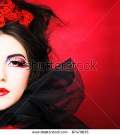 http://image.shutterstock.com/display_pic_with_logo/346987/346987,1292705010,12/stock-photo-queen-of-hearts-creative-lady-in-black-and-red-colors-and-with-bright-make-up-67479835.jpg