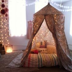 Use Christmas lights and a huge skirt, curtains, sheets, or huge dress from good will to make tent