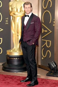 Chris Hemsworth The Rush star and presenter wore a burgundy three-piece tuxedo with a black lapel and bowtie and a Montblanc watch.