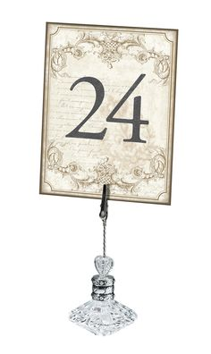 """Double-sided vintage gold table numbers (1-24) bring traditional style with a modern touch to each table. They measure 4.25"""" x 5.5"""". Table marker holders sold separately."""