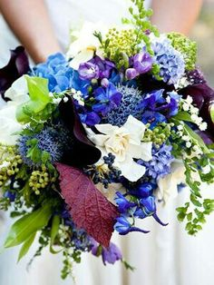 Pretty Color Palette Used In This Bouquet... Blue Allium, Delphinium, Hydrangea, Hyacinth, Green China Berry, Lily Of The Valley, Purple Freesia, Purple Calla Lilies, White Gardenias, Mixed Green & Burgundy Foliages······