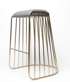 Phase Design's bar stool with upholstered seat and smoked brass solid steel frame was inspired by the graceful fall of a bridal veil.    ...