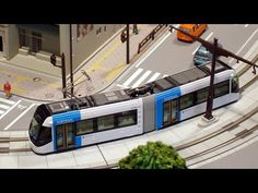 This video features a Japanese model tram/LRV layout. It is x cm x 76 cm) and has four tram stops.