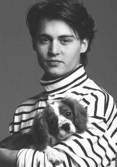 Actor Johnny Depp holding cute dog! #dogs #pets #CavalierKingCharlesSpaniels Facebook.com/sodoggonefunny