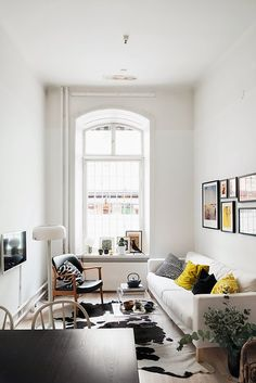 If you want a Scandinavian living room design, there are some things that you should consider and implement for this interior style. Wood as a material has an important role as well as light colors, because they give the living… Continue Reading → Narrow Living Room, Home Living Room, Apartment Living, Living Room Decor, Apartment Therapy, Cow Hide Rug Living Room, Living Area, Latest Furniture Designs, Scandinavian Interior Design