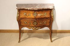 A French rosewood, marquetry & marble top antique commode