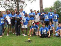 Aerospace Engineering campers group photo with model rocket launch