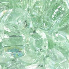 These square pieces of fire glass are shaped like small ice cubes and come in a variety of attractive colors. Flames wrap around the clean, straight lines of fire cubes to create an entrancing effect. Wood Fire Pit, Glass Fire Pit, Fire Pits, Mint Green Aesthetic, Aesthetic Colors, Fire Rocks, Fire Pit Essentials, Modern Fire Pit, Arctic Ice