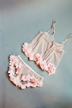 This fabulous cropped cami top is made from sheer pink tulle and features a delicate pink petal trim. Cami top is sheer with adjustable straps and ...