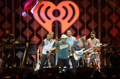 Bruno Mars Photos Photos - Recording artist Bruno Mars (C) performs onstage during 102.7 KIIS FM's Jingle Ball 2016 at Staples Center on December 2, 2016 in Los Angeles, California. - 102.7 KIIS FM's Jingle Ball 2016 - Show