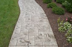 Walkways can provide much needed curb appeal that can add value to your home. Stamped concrete is an economical way to transform boring walkways into charming thoroughfare.