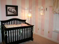 Love the pink & white striped wall. Great idea for baby room!!