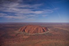 #1 of Largest Monoliths In The World - Uluru (or Ayers Rock) is one of Australia's most recognizable natural icons, located 335 km (208 miles) south west of the nearest large town, Alice Springs. It is the largest monolith in the world. The world-renowned sandstone formation stands 348 meter (1,142 foot) high and measures 9.4 km (5.8 miles) in circumference. The rock undergoes dramatic color changes with its normally terracotta hue gradually changing to blue or violet at sunset to flaming…