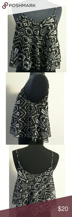 """New Rue21 Geometric Swing Tank Top Size M This really cool cute Rue 21 geo print black and white swing tank top is brand new with tag. Chest:17"""" Length from shoulder to bottom: 19""""  My home is smoke-free and pet-free.  Check out the other items in my closet to bundle two or more items for a great bundle discount.  I consider all offers.  Happy POSHING! Rue21 Tops Tank Tops"""