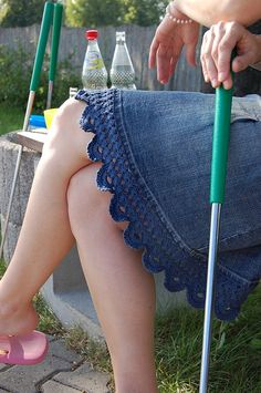 Lace crocheted on the bottom of denim skirt in the same colour as the skirt.