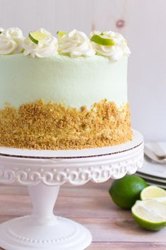 This Key Lime Cake features three layers of fluffy white cake with a hint of lime, a buttery graham cracker crumble in between each layer, and a sweet yet tangy key lime buttercream frosting. classic summer flavors and perfect for any gathering! Key Lime Buttercream, Buttercream Frosting, Key Lime Kuchen, Food Cakes, Cupcake Cakes, Big Cakes, Just Desserts, Delicious Desserts, Cake Toppers