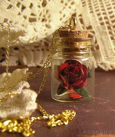 Beauty and the Beast rose necklace.