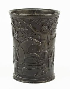 "Just Andersen (Danish, 1884-1943) A Pewter Cup. Solid pewter cup with heavily sculpted scenes of Medieval Viking warriors. Circa 1920 5.25"" x 4"""