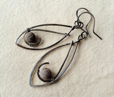 Modern asymmetry with silver stardust beads by Aniko Sandor.