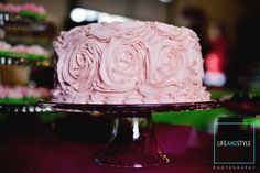 Loving this ruffled rose frosted cake by Just Friends Catering!