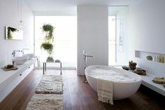 Simple white bathroom w/ wooden floor