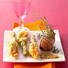 Découvrez la recette Carré d'agneau et beignets de fleurs de courgettes sur cuisineactuelle.fr.
