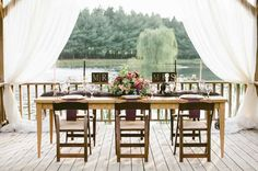 simple wood tables, burlap runner and fresh flowers in mason jars....
