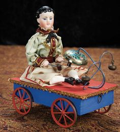 Wonderful French Pull-Toy in Choice Original Condition with Rare Doll 2500/4500