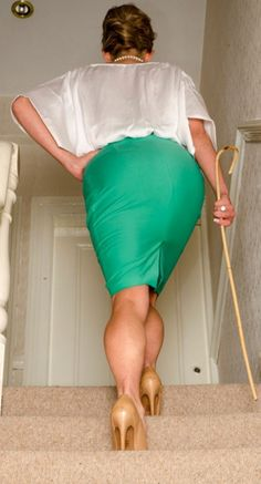 A Stepford trainer on her way to instruction class. Obey & Adore Her
