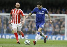 Cesc Fabregas runs with the ball
