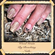 Wood grain nails. But I would do dark brown base with beige for the graining