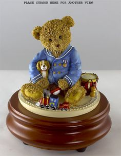 $ 69.00Music choice: Available Tunes - U - LITTLEST CONDUCTOR by Adrienne Samuelson. Darling little bear sitting by his train from her ThreadBear collection. Plays the ever favorite 'YOU ARE MY SUNSHINE'. USMAS003. Regularly $89.00.... 5x5 x 4 inches... USMAS003