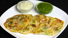 Uttapam is a popular South Indian dish. Traditionally uttapam is made with rice and lentil batter, which can be a long process. Bread Uttapam, on the other hand, is instant and easy to make. Not to mention it tastes delicious. Uttapam is a thick dosa, or pancake, with vegetables cooked over skillet. It tastes divine served hot and with a side of coconut chutney.