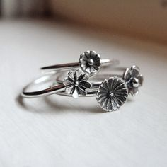 Wildflower Bouquet in Sterling Silver - Tiny Flower Stacking Rings Set of Four on Etsy, $48.00