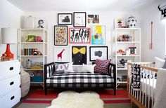 An eclectic nursery with gallery wall and checkered day bed