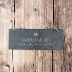 Personalise this Heart Motif Slate Door Sign with one line of 25 characters which will be in bold, and one line of 40 characters for a longer message. Above the personalisation is a cute heart motif. The door plaque has a piece of natural, rustic string which enables this item to be hung up.  PLEASE NOTE- Each slate piece will be unique as the item is cut by hand. Due to the nature of slate there will be some differences in the stone (such as texture, cut and smoothness). This may result in…
