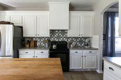 Stenciled backsplash, DIY vent hood, adding height to cabinets--House Over Head blog