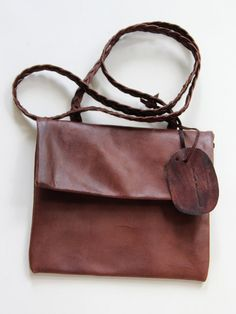 Handmade, leather handbag in sienna brown leather.