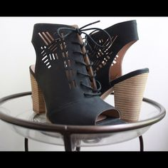 Cut-Out Ankle Boot Heals Easy to walk in heals with a tribal cut out design. Negotiable! Restricted Shoes