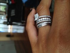 engagement ring, wedding band, & a band for each child. Love the idea, and I love stacking rings!