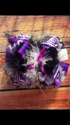 Gorgeous purple, black, and white over the top bow!! This bow comes with your choice of elastic headband or alligator clip. Headband sizing