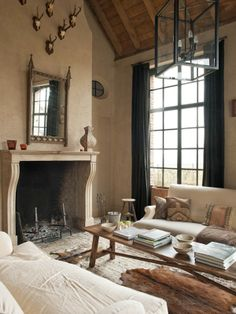 Big open fireplace does it for me, mantle, mix of light & dark, wood accents, feels old but very comfortable