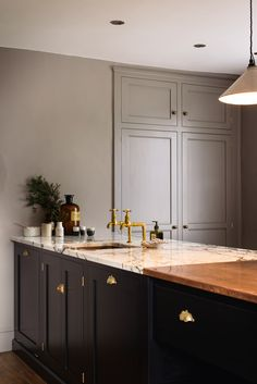 An amazing mixed copper and San Simone Quartzite worktop, aged brass taps and handmade cup handles - deVOL
