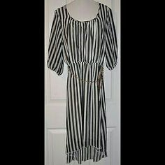 """Black White Striped Dress. Hi-Lo. NWT. Large Beautiful vertical striped dress. Hi-lo style. Lined. Flowy. Gold link chain belt. 1/2 Sleeves. 100% Polyester. Shoulder width: 16"""". Front length: 40"""". Back length: 45.5"""". Andrea Missy Dresses High Low"""