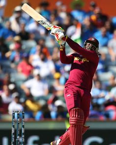 Chris Gayle gives it his all while playing a pull shot, India v West Indies, World Cup 2015, Group B, Perth, March 6 | www.indiadefends.com #indiadefends