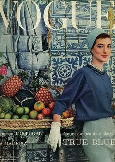 UK VOGUE cover - January 1957 - blue portuguese tile and fresh and tasty fruits from Madeira. Model is wearing a creation by Givenchy. Story: Spring in Portugal and Madeira.