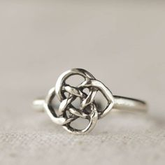 A lovely detailed Celtic Knot Ring. Wonderful woven details in sterling silver. Casual and comfortable to wear every day. The knot measures 10mm across.