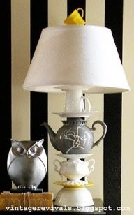pick up some old teapots at sales, old lamp for the insides and shade. Paint one color?