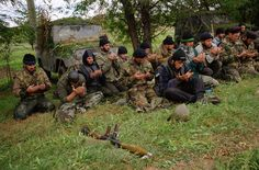 Chechen rebels praying before going off to the frontline to fight the advancing Russian army. During Russia's second war in Chechnya. 10/1999